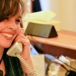 Kristen Elaine answering the phone